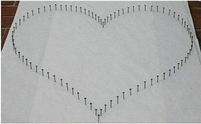 用线和铁钉织颗心